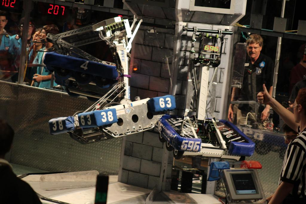 3 robots hanging
