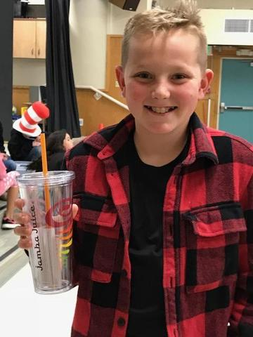 Student holding Jamba Juice cup