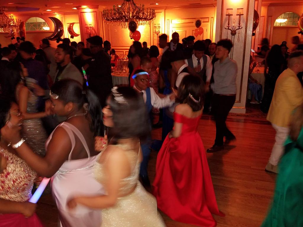 Students dancing on dance floor