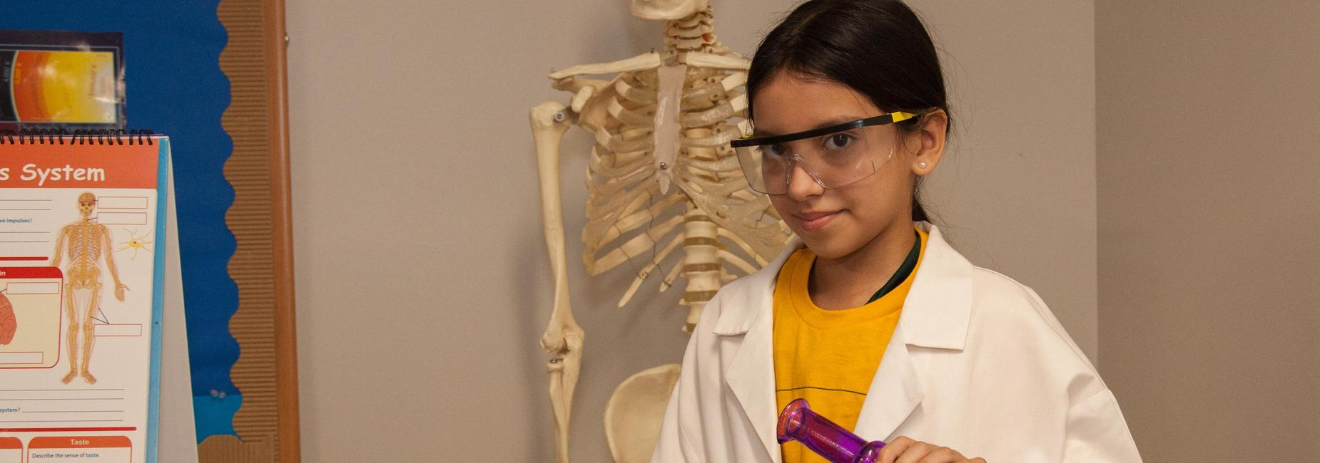 female middle school student in science lab