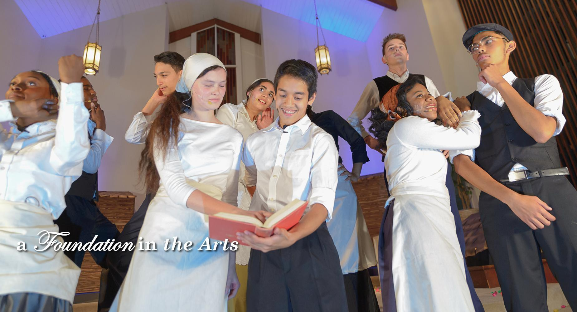 a foundation in the arts with students acting in the Fiddler on the Roof play