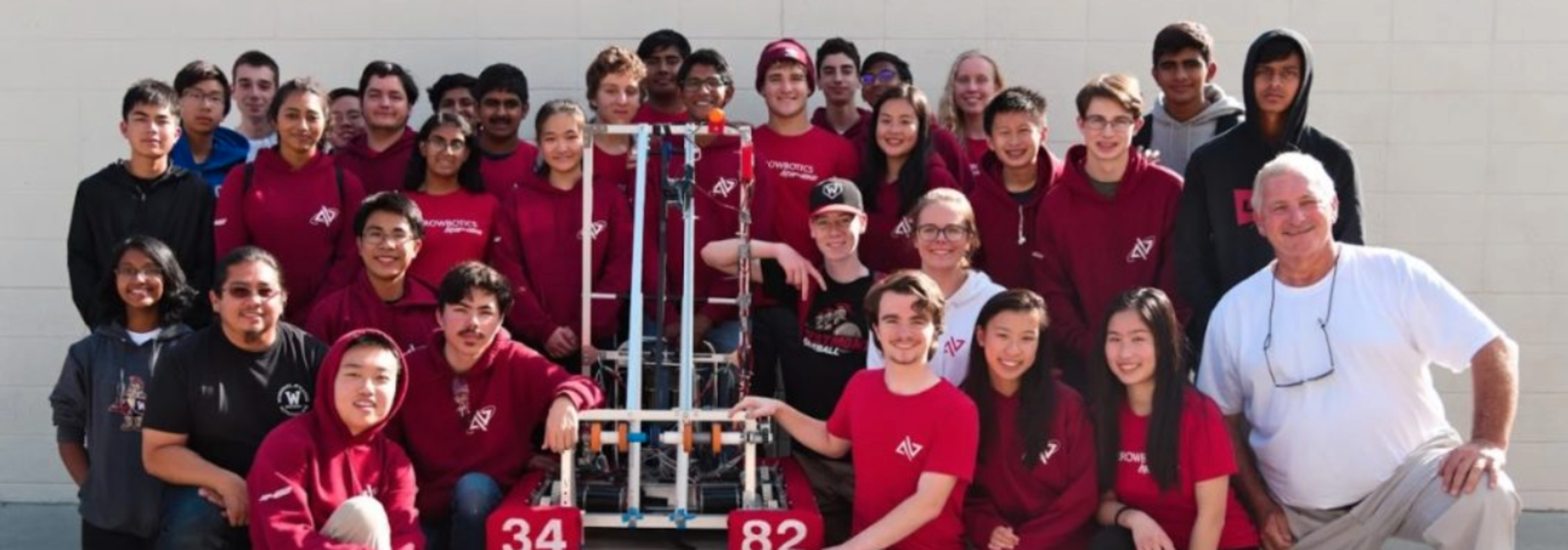 Photo of the whole Robotics Club with their robot in early spring of 2020