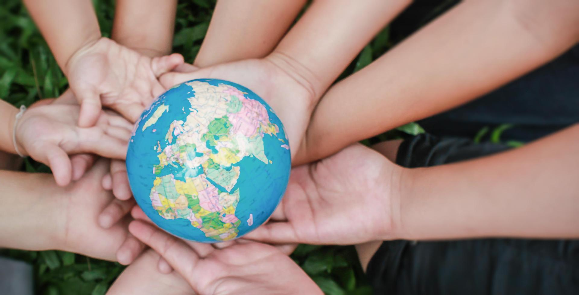 photo of kids holding globe