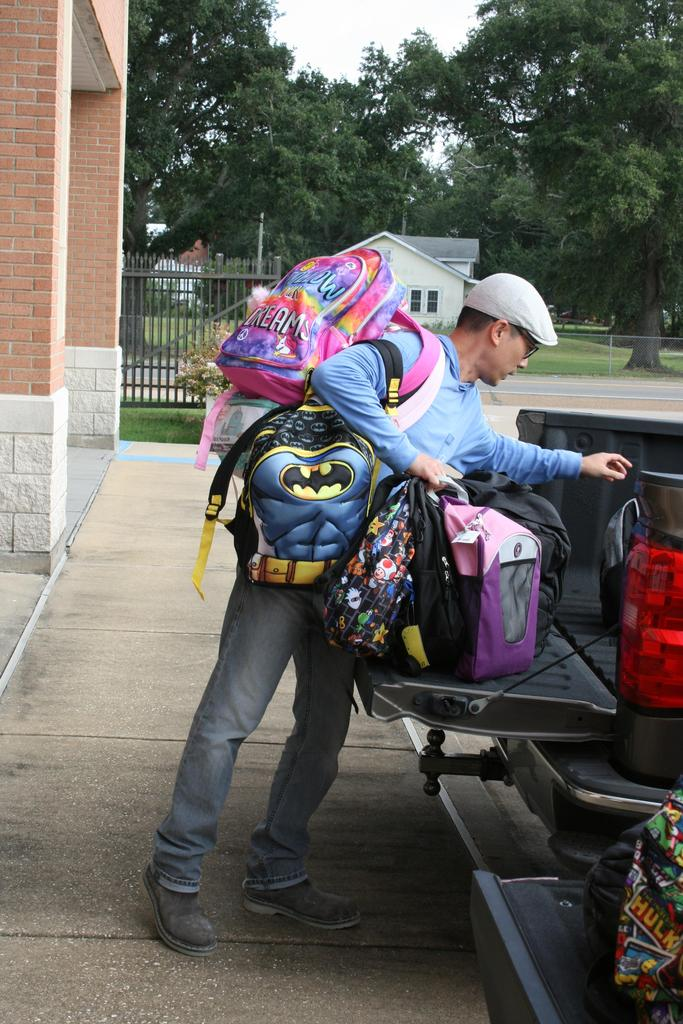 Employee unloading backpacks