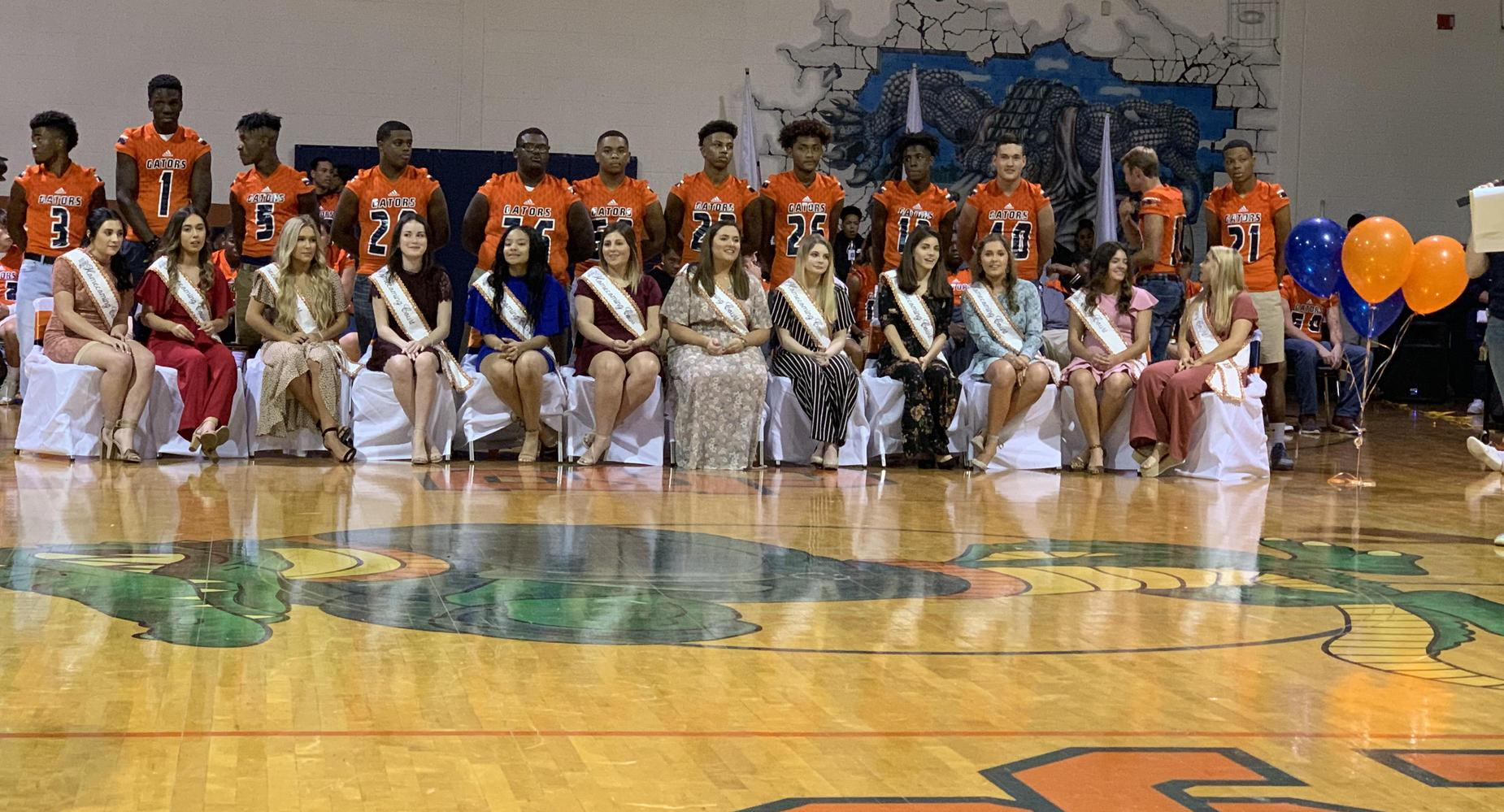 Homecoming Court escorted by Football Players at the Pep Rally