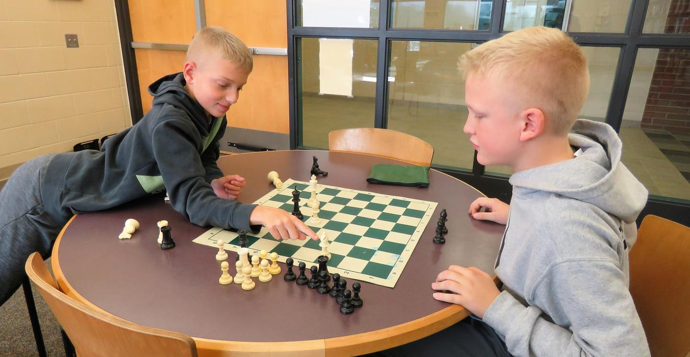 TK students learn to play chess in an after-school chess club.