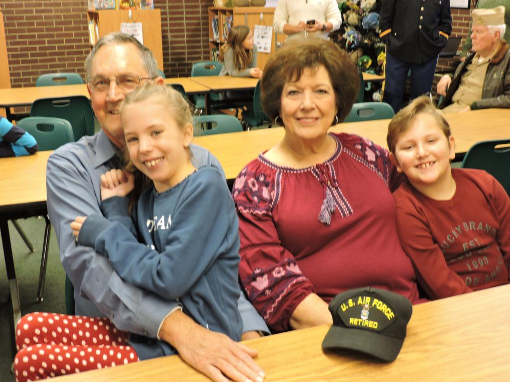 Students with Veteran and his wife