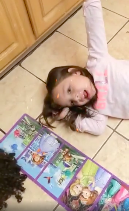 Girl on floor with open princess book