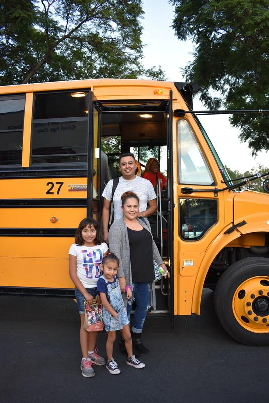 Family gets off the bus for the Twilight Program