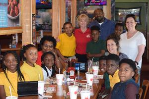 Higgins students celebrate AR points at Applebees.