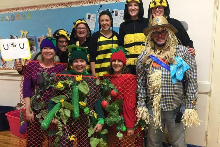 McKinley principal Marc Biunno and his staff dress as the school's garden, complete with scarecrow, vegetable plants and bee pollinators.