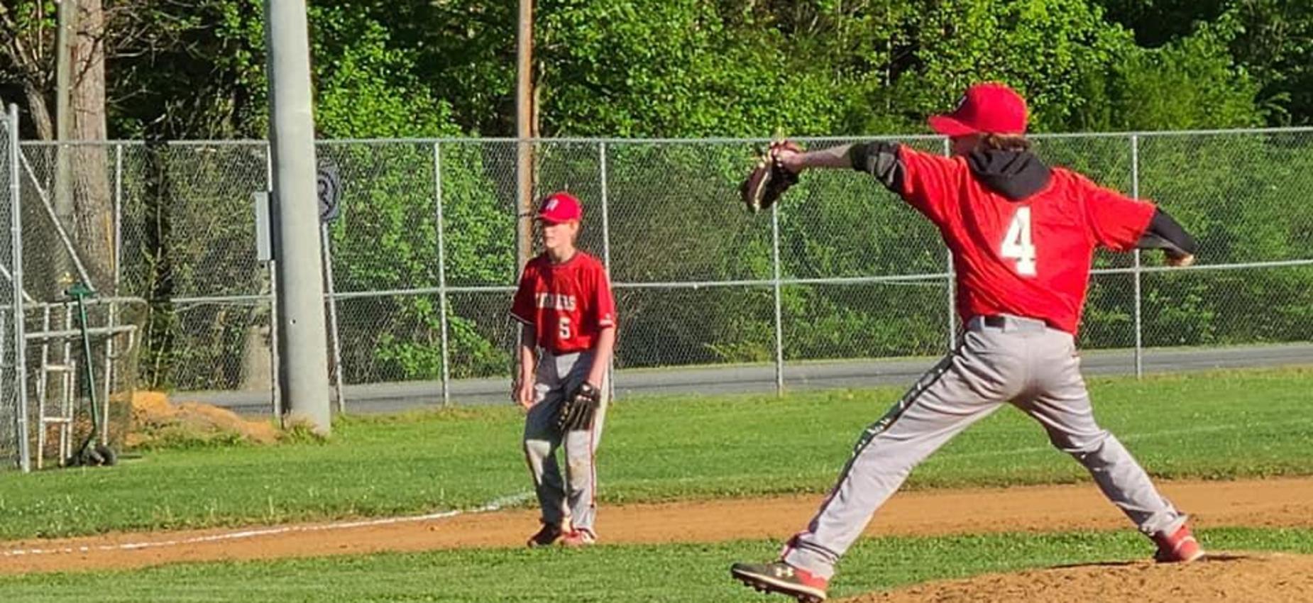 A pitcher throws a baseball.