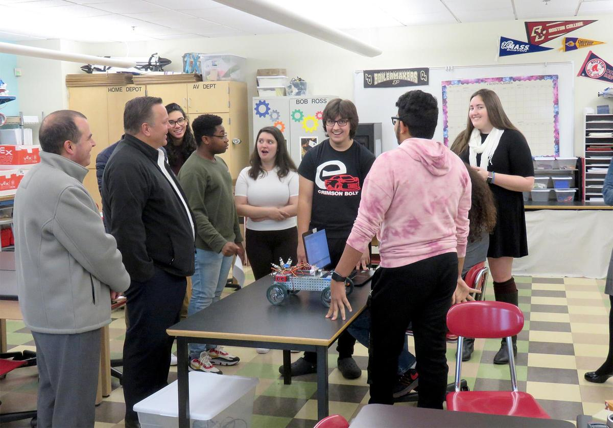 Students and teacher Anna Seiders talk to Exelon Generation executive Archie Gleason