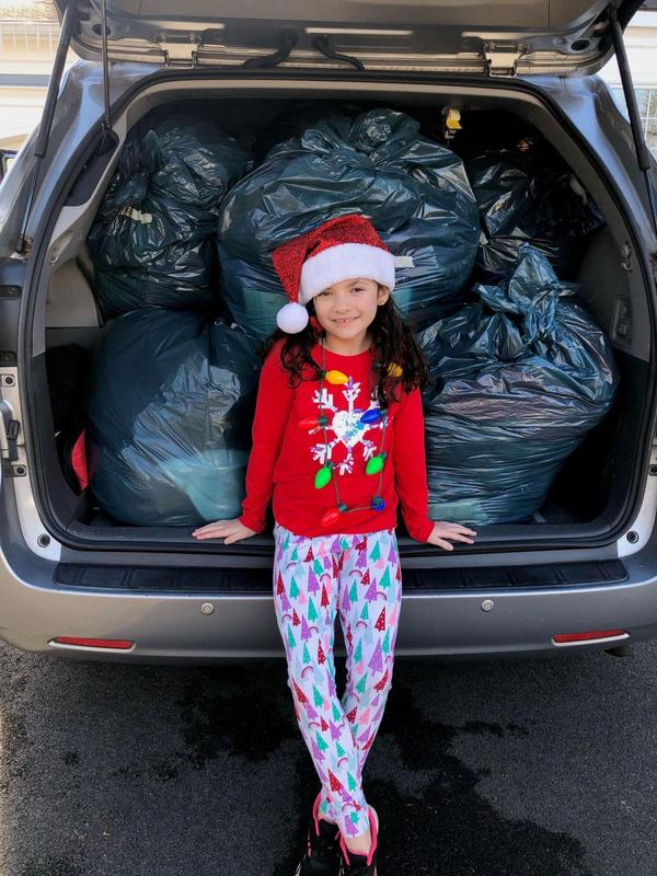 Jefferson School 4th grader Kayleigh Bucciarelli joins her mom in delivering more than 300 coats collected by her schoolmates for Jersey Cares.