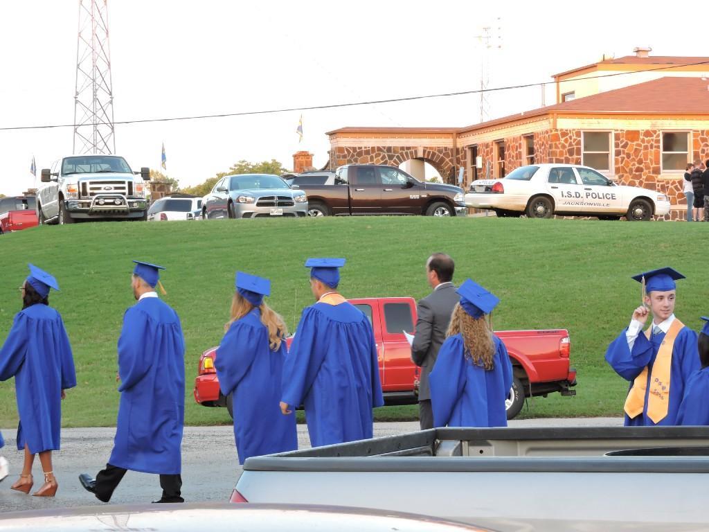 graduates walking to Tomato Bowl