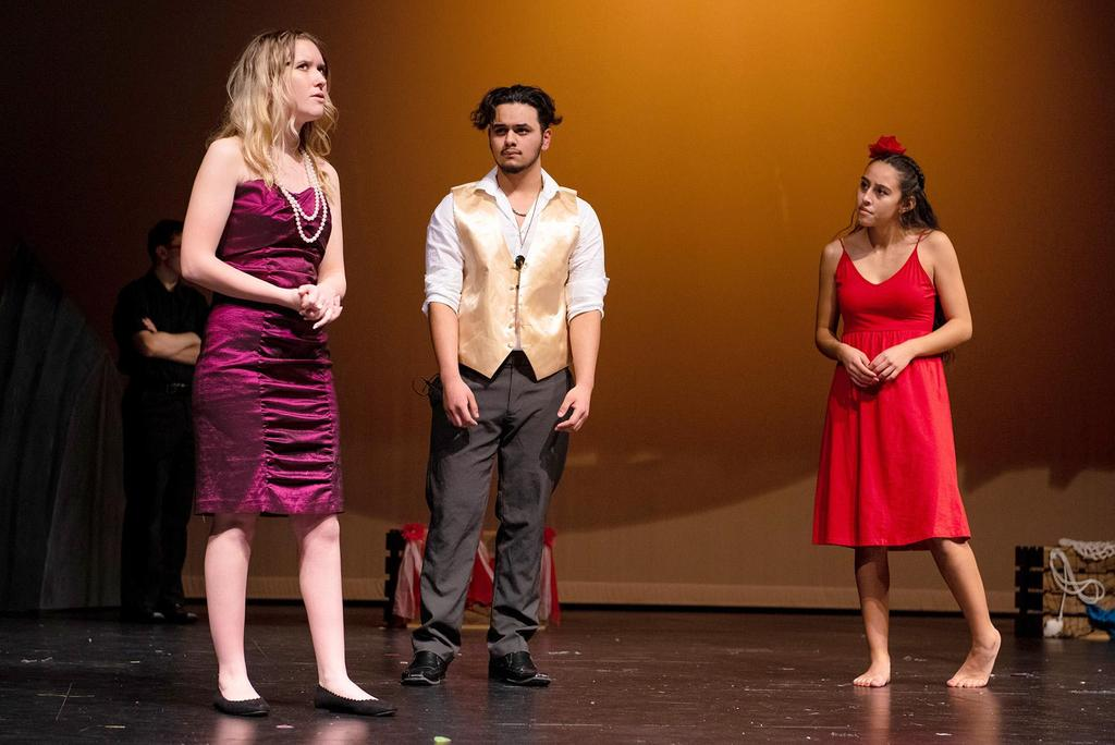 May Bowman as Andrea Deveroux, Anthony Villatoro as Daniel Bouxhomme, and Jhalyshka Feliciano as Ti Moune share the stage during a scene