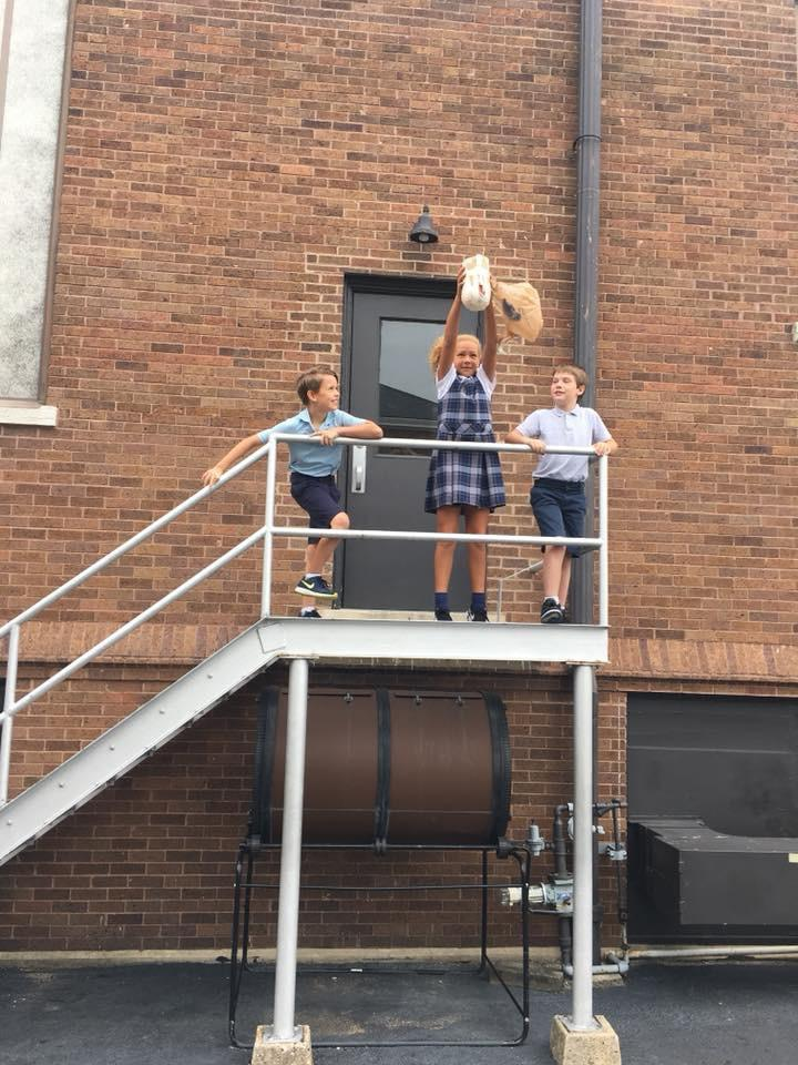 students doing an egg drop experiment