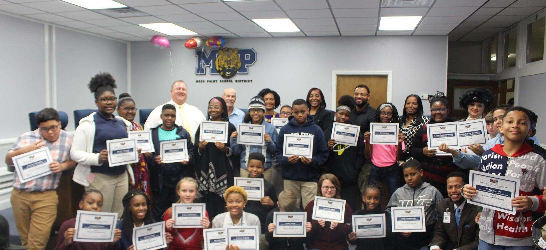 students at board meeting receiving recognition