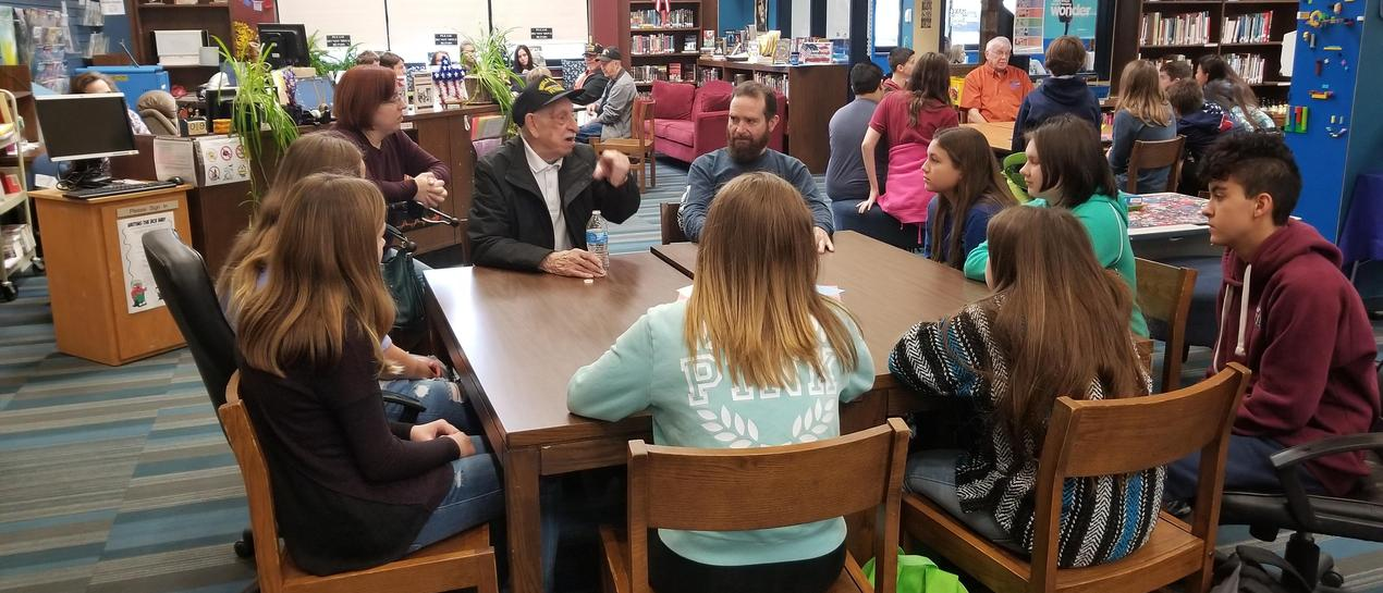 veteran talking with 9th grade students