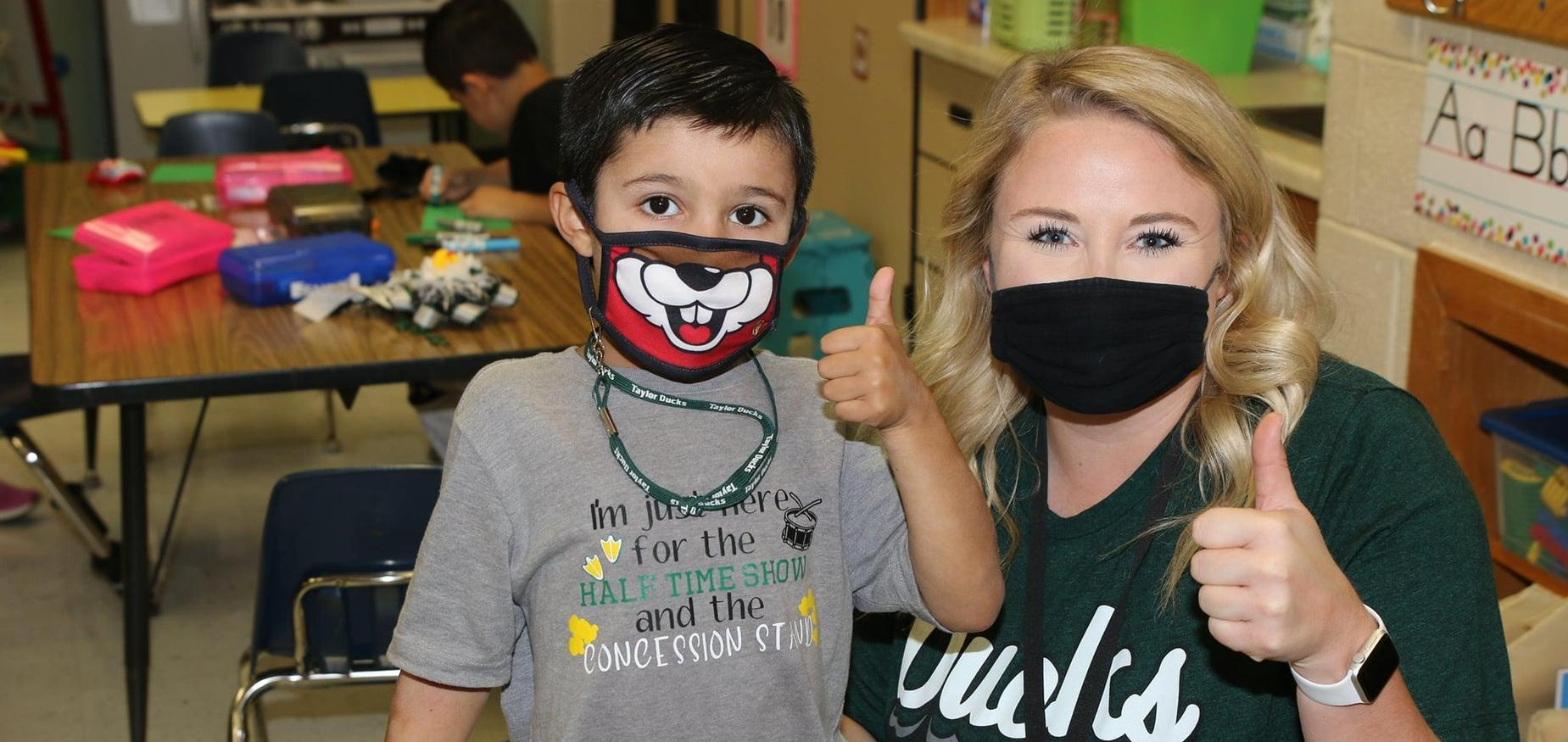 Student and teacher give thumbs up!