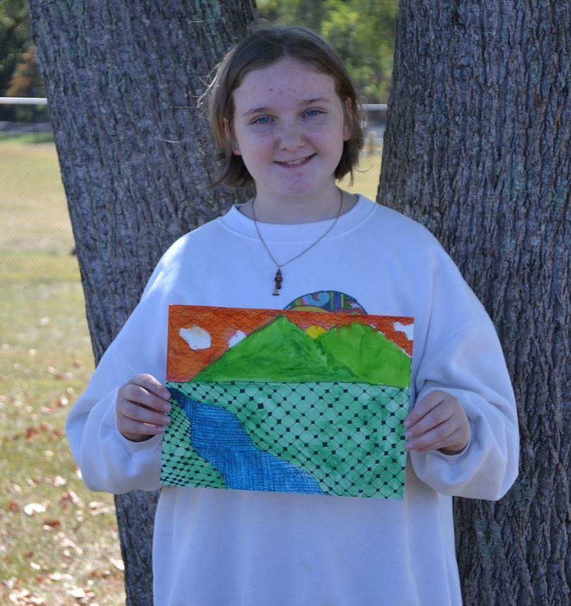 Girl holding her artwork.