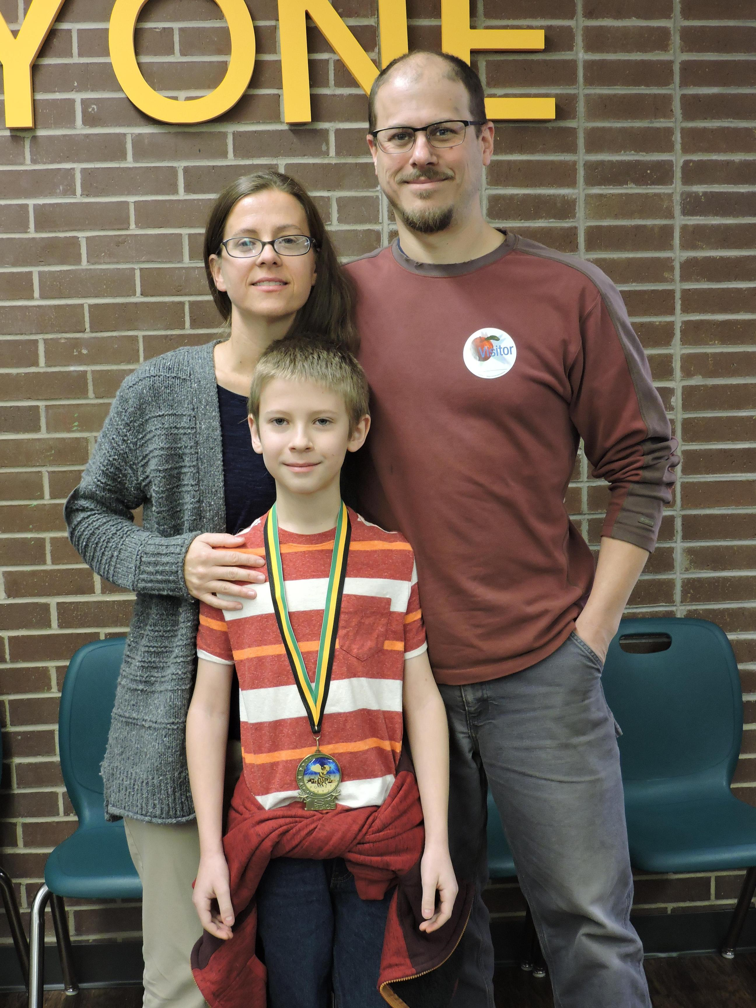 Spelling Bee Participant with parents