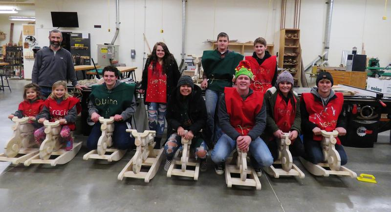 TKHS woods students made and delivered wooden rocking Harley motorycle toys.