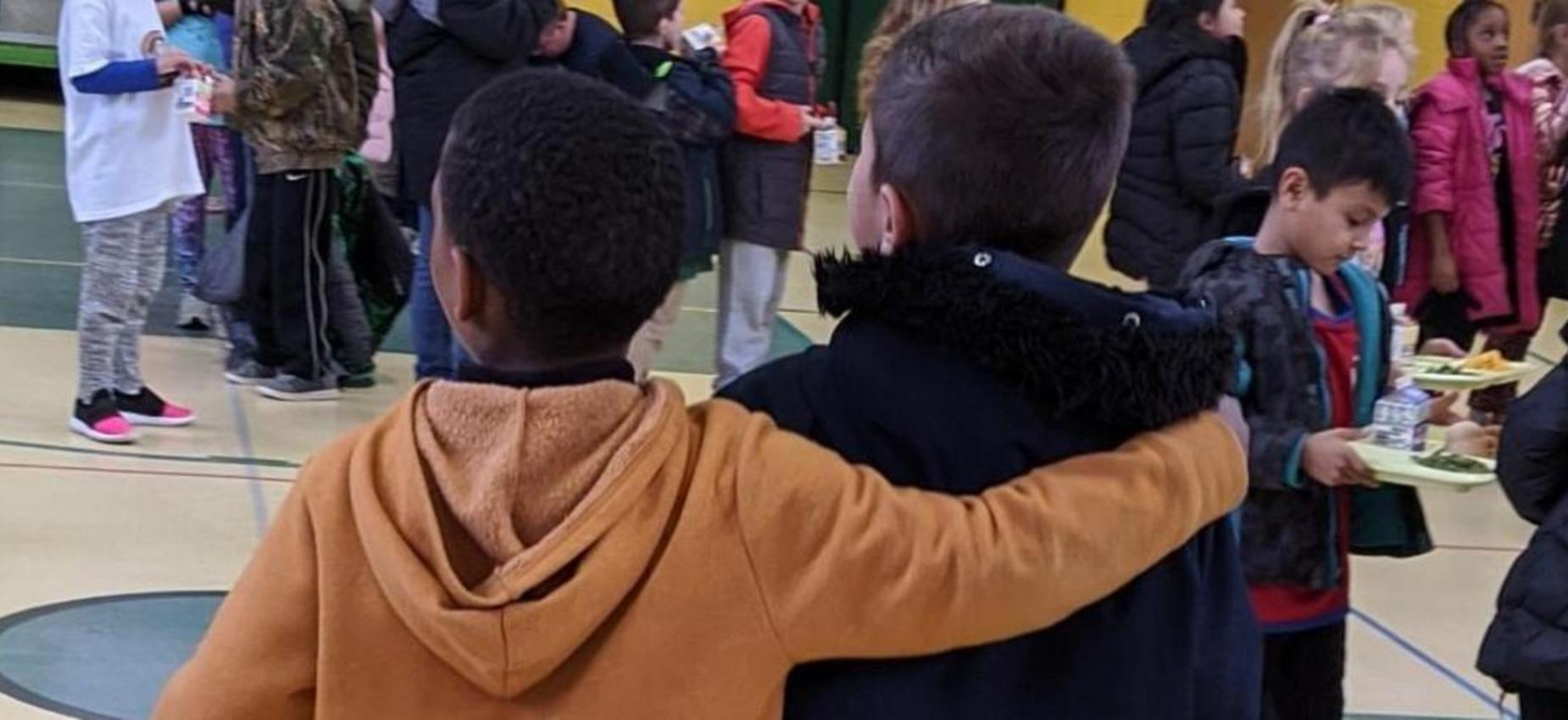 Student with arm around another