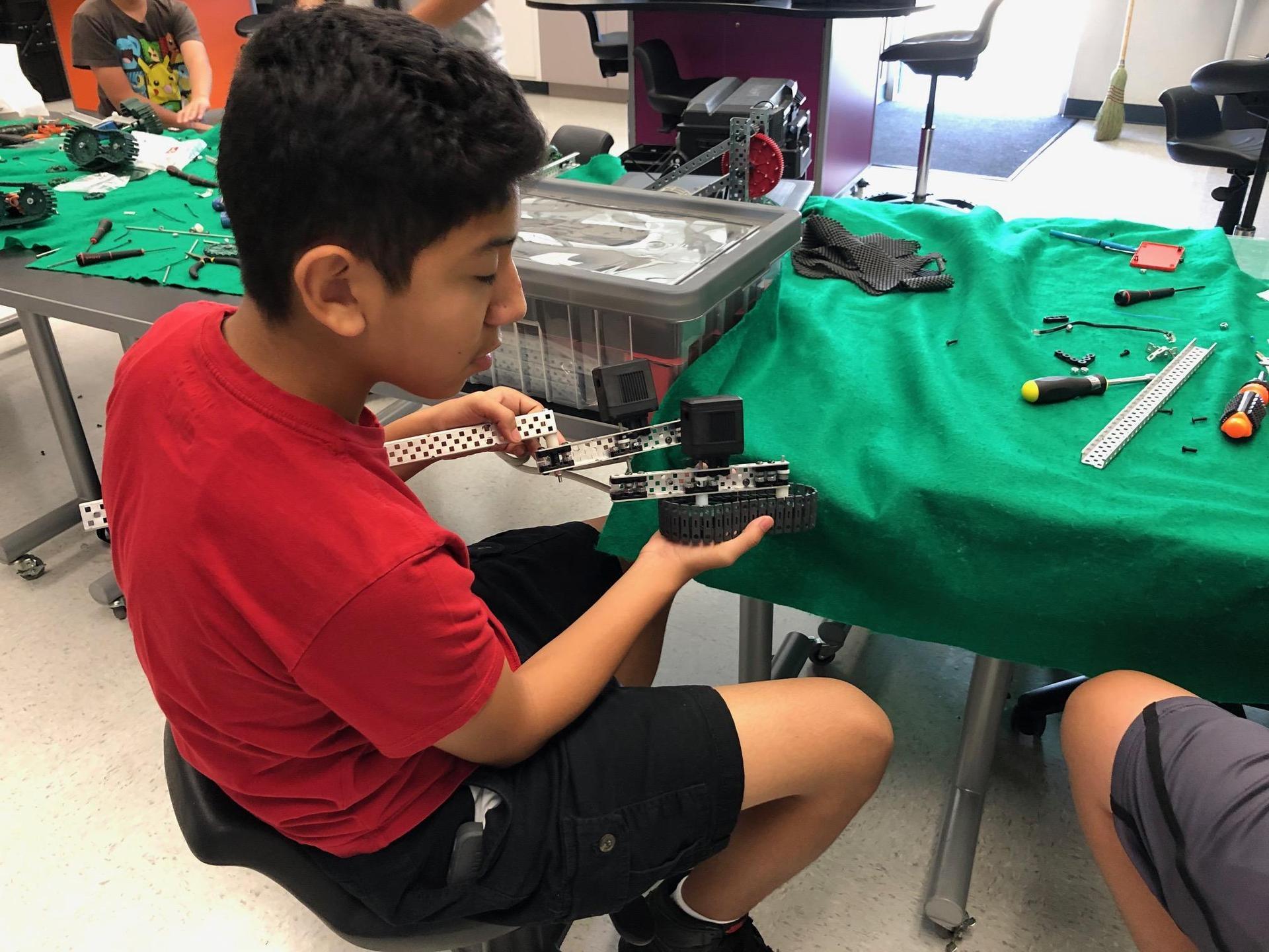 student working on vex robot 2
