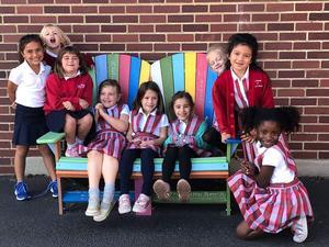 girls on bench horiz.jpg