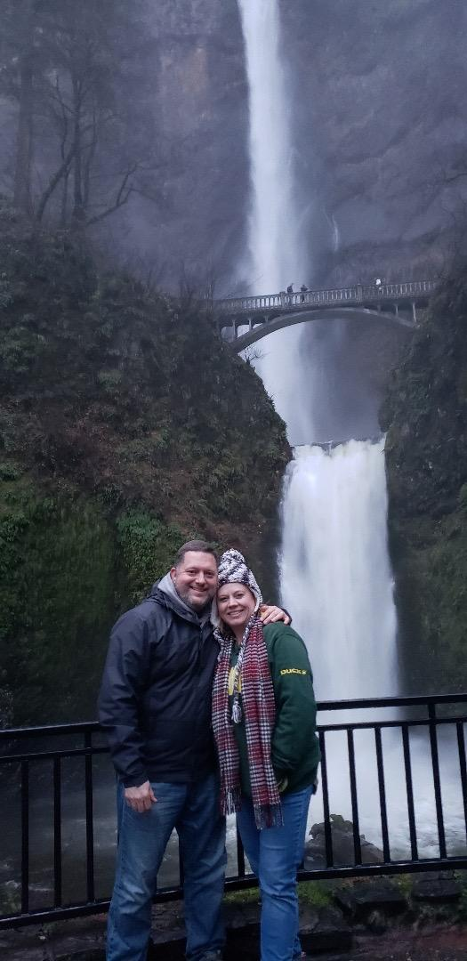 Me and my husband in front of a waterfall
