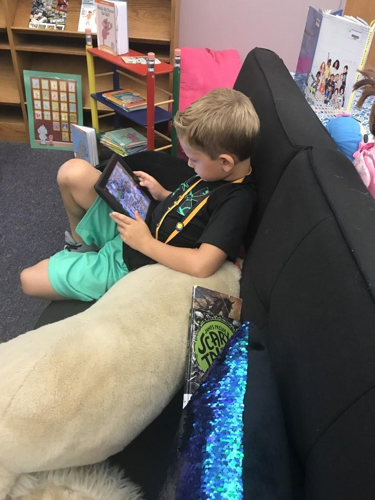 One student playing on iPad