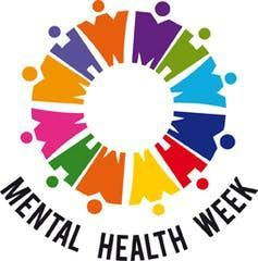 rainbow figurines in a circle with a sign that says mental health week