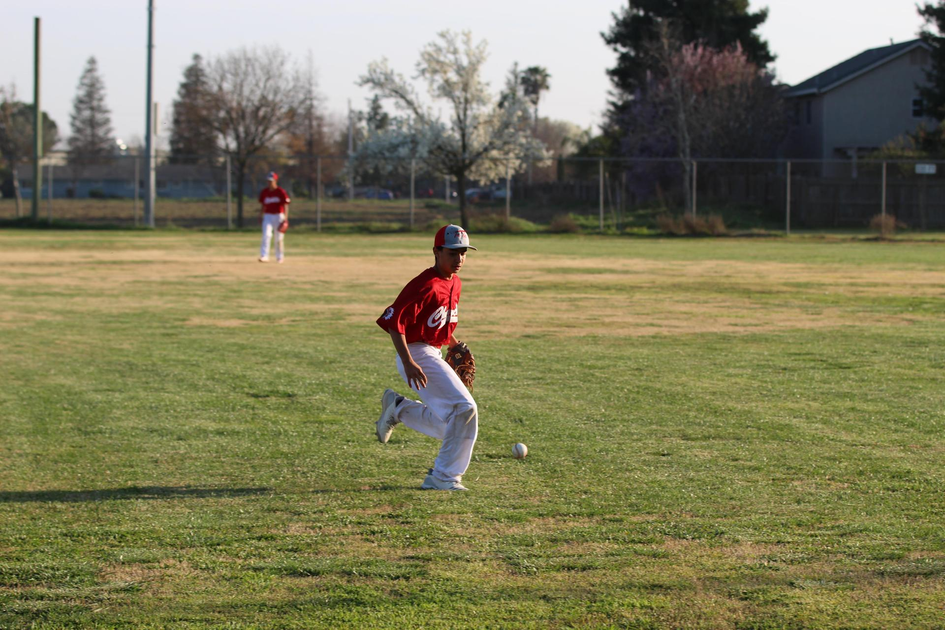 boys playing baseball against Sierra Pacific