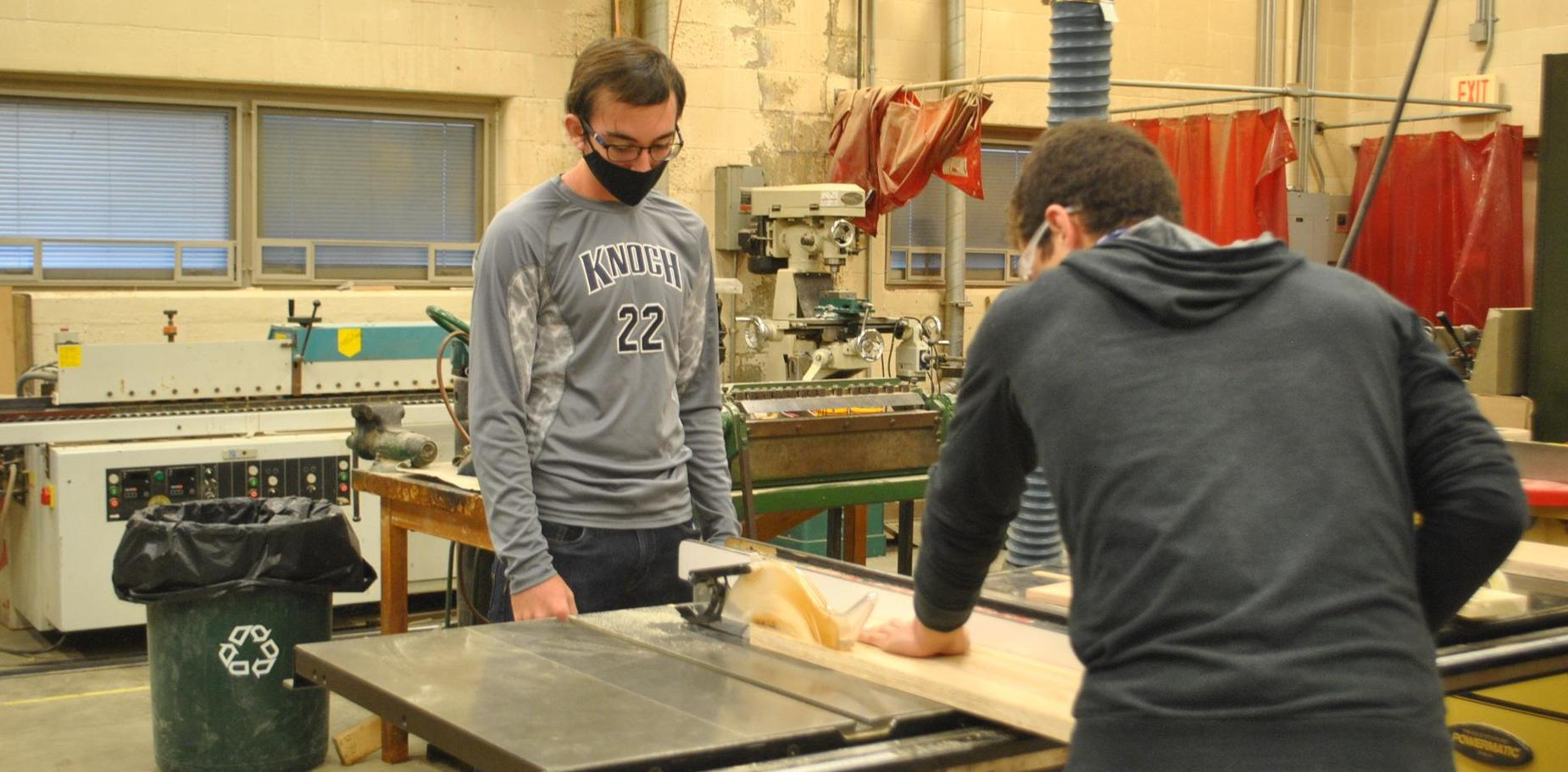 Tech Ed students using saw