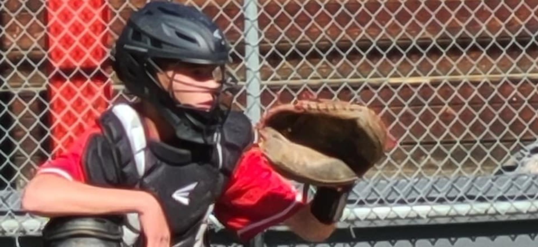 A baseball catcher waits to catch the ball.