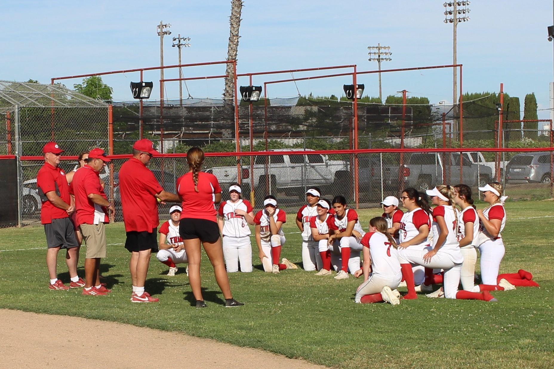 Coaches and players talk after the game