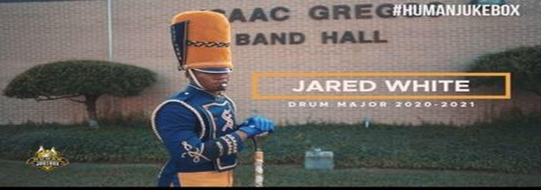 a photo of former Baker High School Drum Major, Jared White, in front of the SU Band Room as the 2020-2021 SU Human Jukebox Drum Major