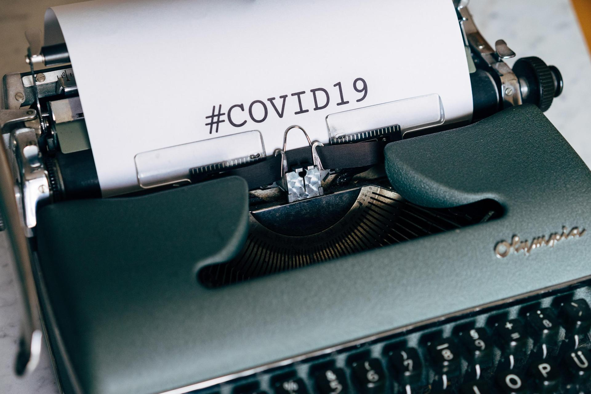 typewriter with #covid19 typed on paper