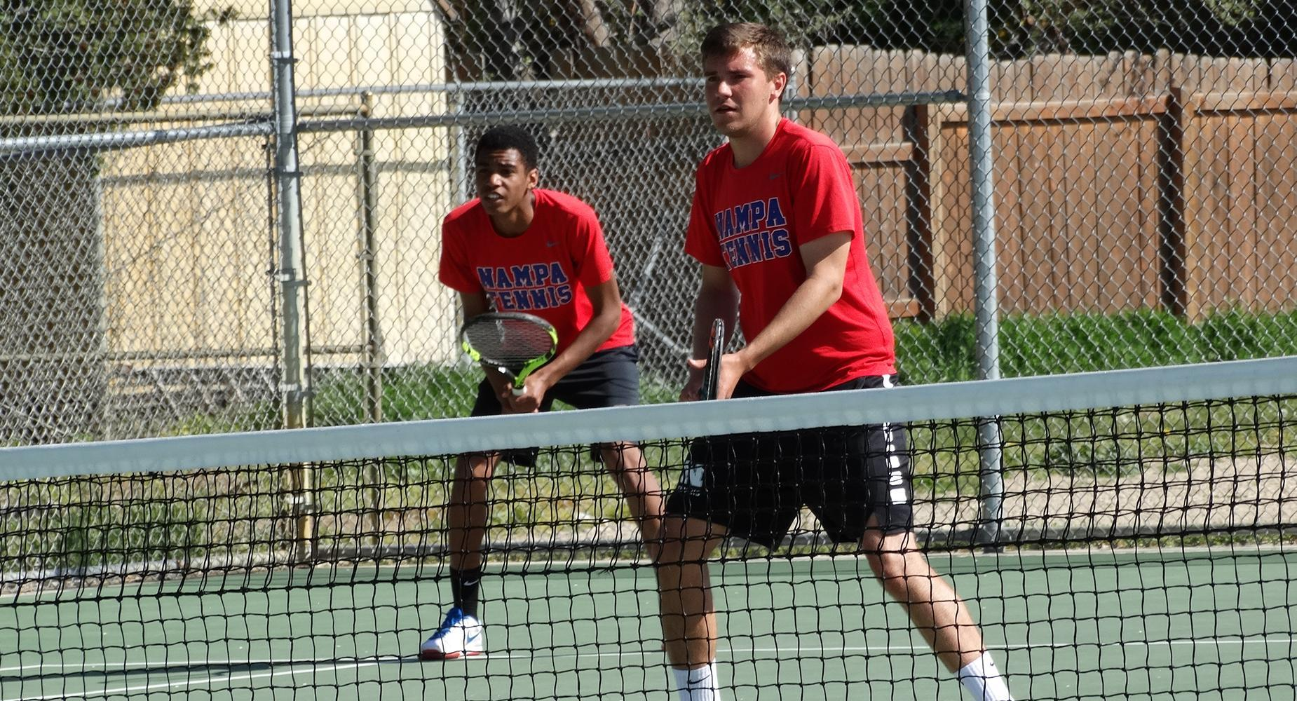 NHS tennis players in a double match