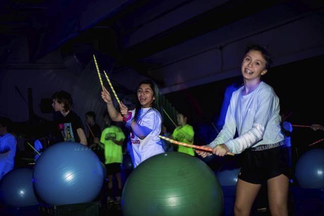 Franklin Regional students incorporate drumming, Lasers, blacklights into gym class Featured Photo