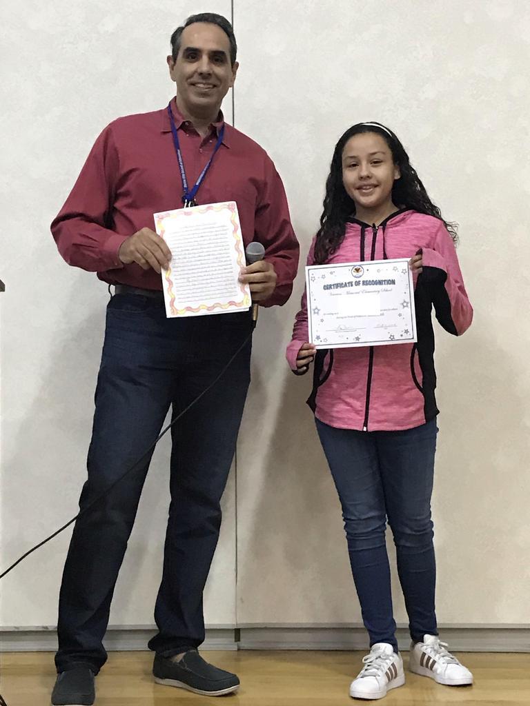 k. garay and vp calvo with her winning essay and certificate