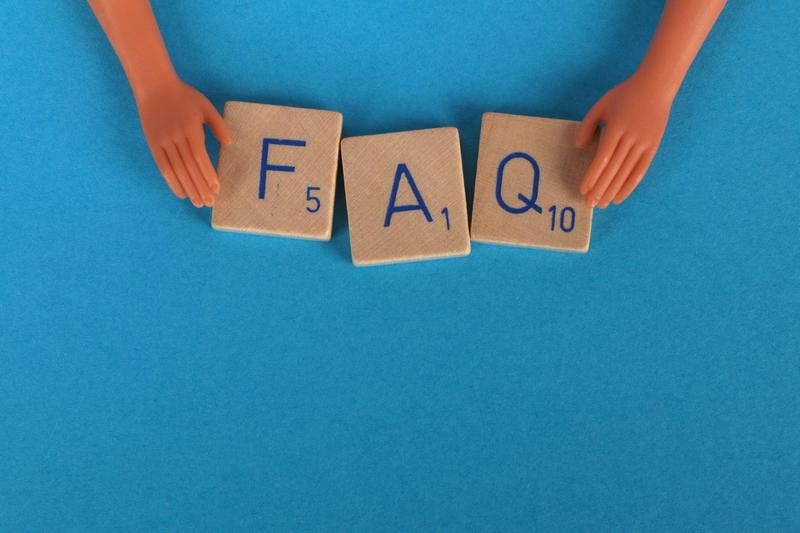 Blue background with Scrabble tiles that say FAQ