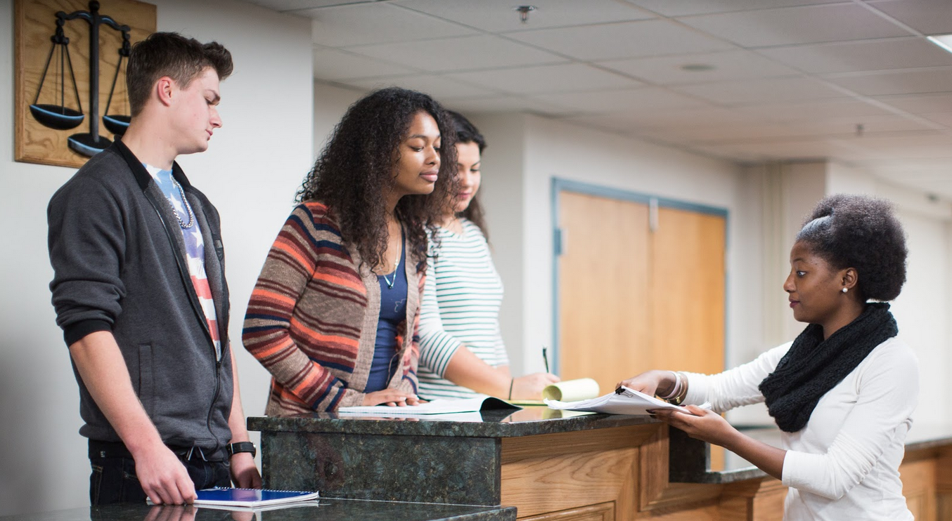 Students examine a text in the HSC Courtroom