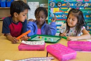 3 kindergarten students doing math