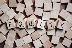 equity spelled out in scrabble