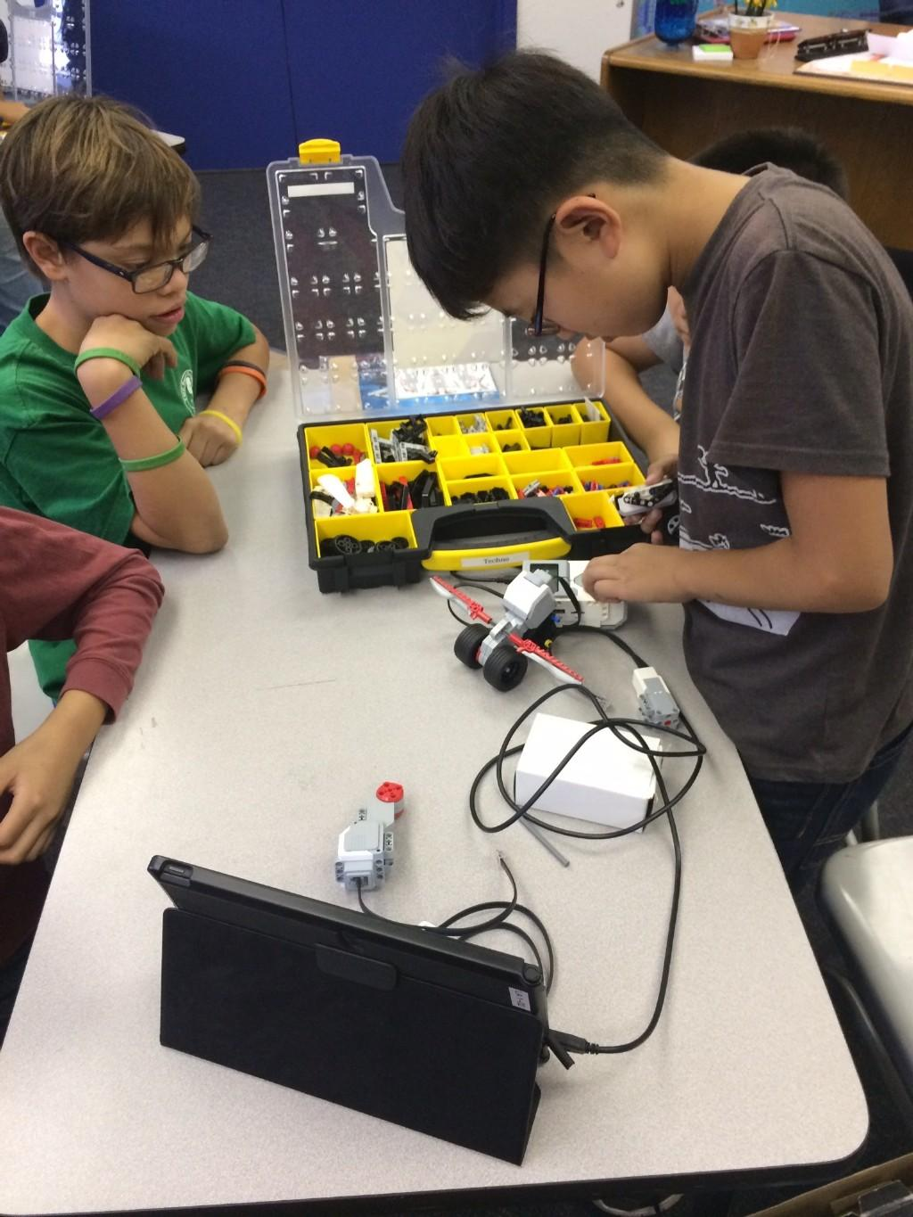 Student working with robot