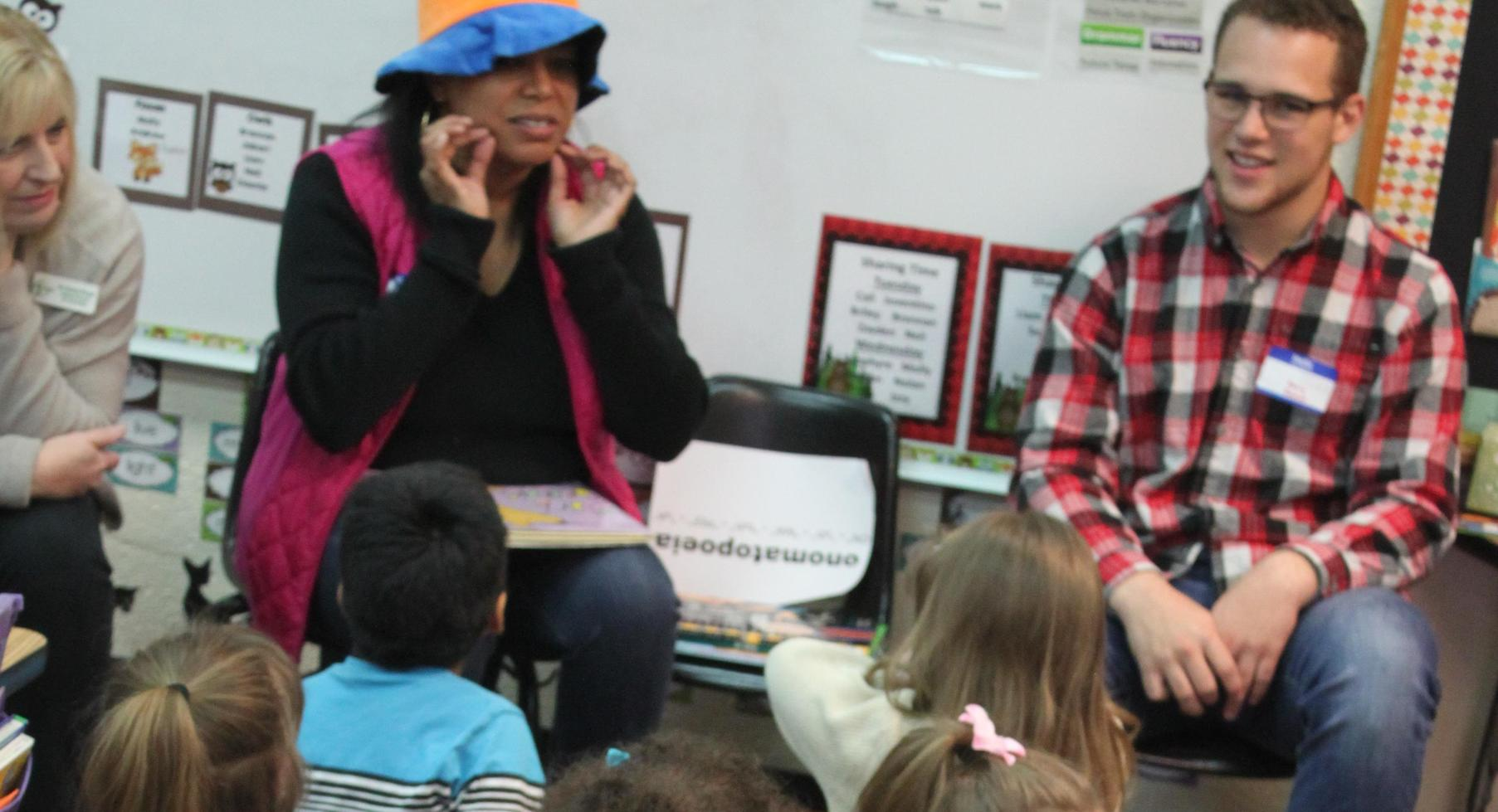 Group reading to students.