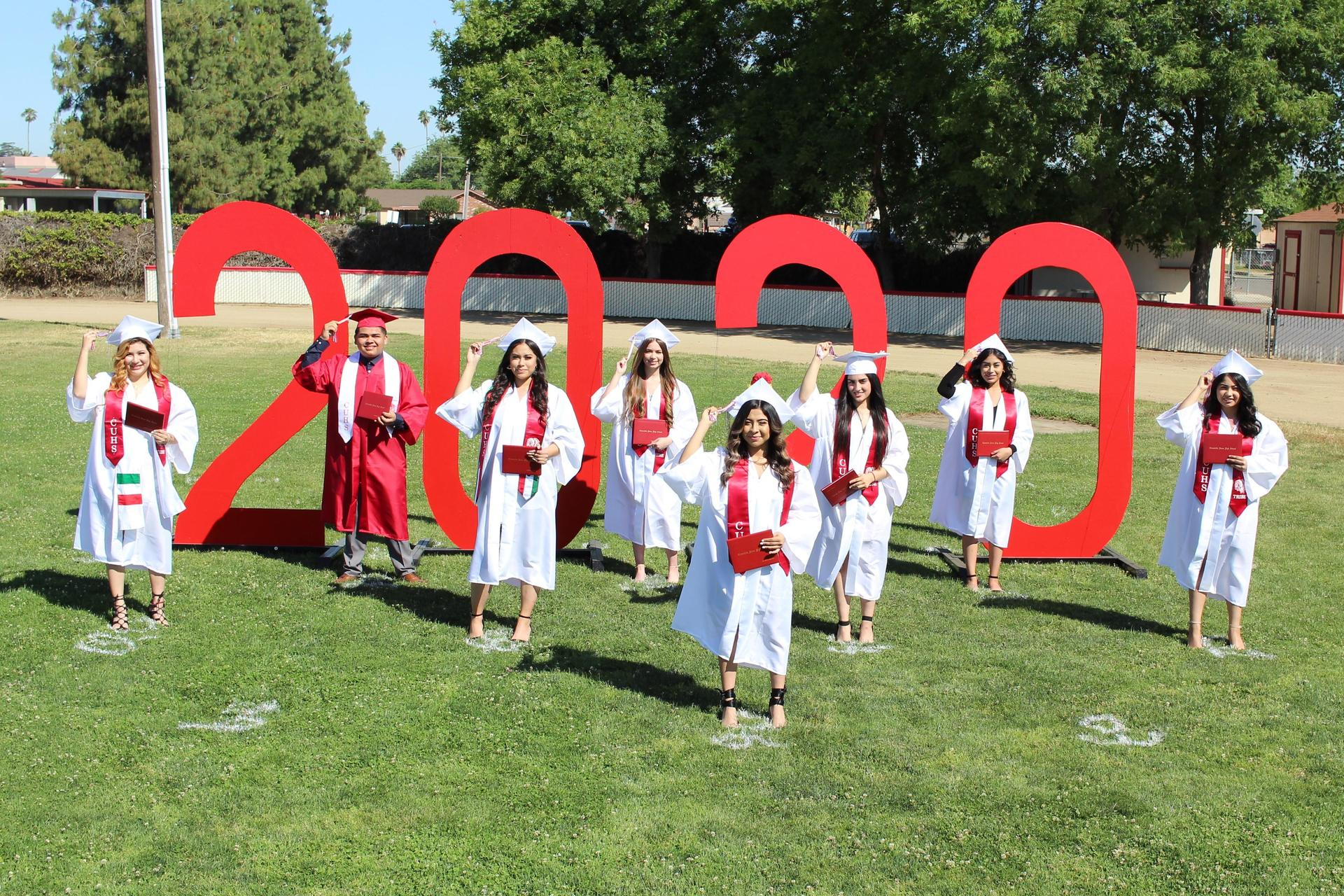 Left to right, Andrea Navarro, Miguel Quintero, Christina Morales, Samamtha Byrd, Eli Sayda Guillen, Natshelly Campos, Sharon Salas and Daniela Avalos turning their tassels