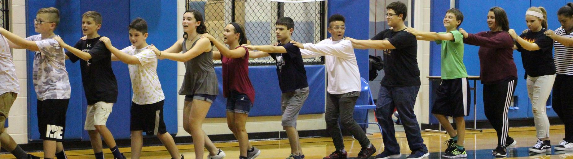 Gananda Middle Schoolers learn communication through a human chain exercise